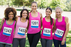 Confident women participating in breast cancer marathon Stock Photography