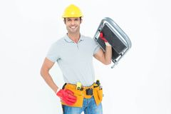 Confident worker carrying step ladder Royalty Free Stock Image