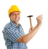 Confident worker hammering in Stock Photos