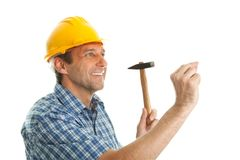 Confident worker hammering in Royalty Free Stock Photos