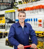 Confident Worker In Hardware Shop. Portrait of confident worker smiling in hardware shop Royalty Free Stock Photos