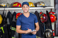 Confident Worker Holding Clipboard At Fire Station Royalty Free Stock Image