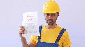 Confident worker holding employee rights information paper stock video