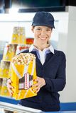 Confident Worker Holding Popcorn At Cinema Stock Photo