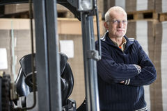 Confident Worker Leaning On Forklift Stock Images