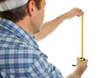 Confident worker measuring dimensions Royalty Free Stock Photos