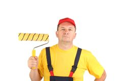Confident worker with paint roll. Royalty Free Stock Image