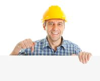 Confident worker presenting empty board. Isolated on white Royalty Free Stock Photos