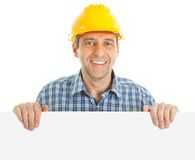 Confident worker presenting empty board. Isolated on white Royalty Free Stock Images