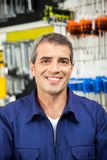 Confident Worker Smiling In Hardware Shop Royalty Free Stock Photos