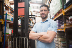 Confident worker smiling in warehouse. Portrait of a confident worker smiling in the warehouse Royalty Free Stock Photos