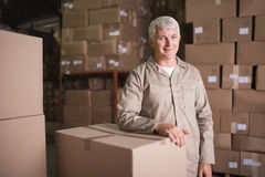 Confident worker smiling in warehouse. Portrait of a confident worker smiling in the warehouse Stock Photo
