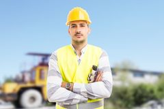 Confident worker standing with arms crossed on a pit royalty free stock photo