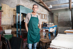 Confident Worker Standing With Hands In Pockets At Factory Stock Images