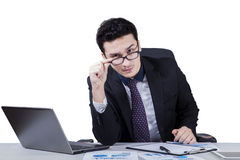 Confident worker staring at camera seriously stock photo