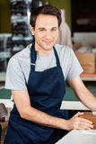 Confident Worker Wearing Blue Apron In Paper Royalty Free Stock Photos