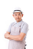 Confident worker with white hat and apron. White isolated background Stock Photography