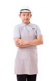 Confident worker with white hat and apron. White isolated background Royalty Free Stock Image