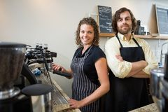 Confident Workers At Counter In Coffeeshop Stock Photo