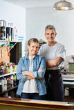 Confident Workers Standing Arms Crossed In Paper Royalty Free Stock Photography