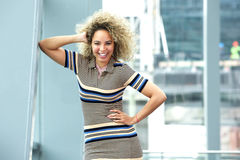 Confident young african american woman leaning. Portrait of confident young african american woman leaning against wall Royalty Free Stock Photo