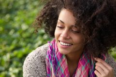 Confident young african american woman smiling Royalty Free Stock Photo