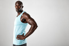 Confident young african man with muscular build Stock Image