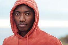 Confident young African man standing outside before for a run stock photography