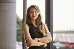 Confident young Asian businesswoman, waist up, close up Royalty Free Stock Image