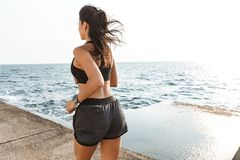 Confident young athlete woman jogging royalty free stock image