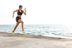 Confident young athlete woman jogging stock images