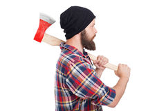 Confident young bearded man holding an axe Royalty Free Stock Photos