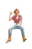 Confident young blond woman showing ok sign Stock Photography