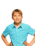 Confident young boy in blue shirt Royalty Free Stock Photo
