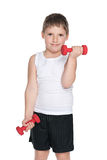 Confident young boy with dumbbells Stock Images