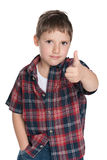 Confident young boy holds his thumb up Royalty Free Stock Photos