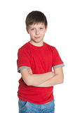 Confident young boy in red shirt Stock Photo