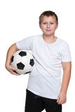 Confident young boy with soccer ball Stock Photos