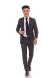 Confident young business man laughing and walking Stock Photo