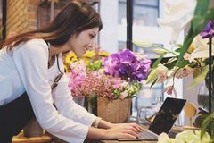 Confident Young Business Owner Flower Shop Store. Stock Photo