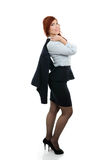 Confident young business woman with coat over her shoulder Royalty Free Stock Image