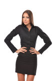 Confident young business woman with hands on waist Royalty Free Stock Image