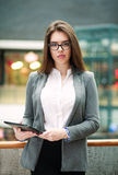 Confident  young business woman holding tablet computer Stock Photography