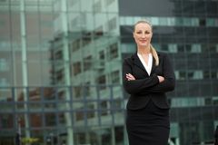 Confident young business woman standing outdoors Stock Photo