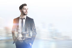 Confident young businessman in a blurred city Stock Photo