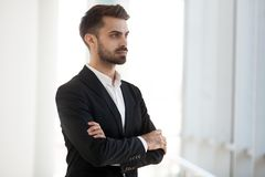 Confident serious company owner thinking looking away stock photos