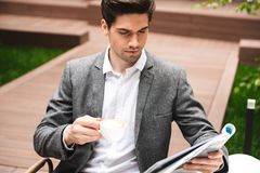 Confident young businessman dressed in suit royalty free stock photos