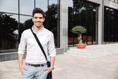Confident young businessman dressed white shirt. Walking outdoors royalty free stock images