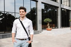 Confident young businessman dressed white shirt. Walking outdoors stock photo