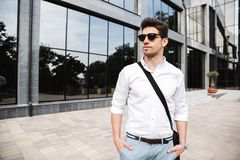 Confident young businessman dressed white shirt. Walking outdoors stock photography